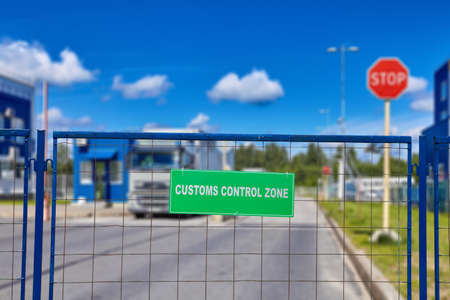 Checkpoint, cargo clearance with the service of temporary storage of goods on a secured bonded warehouse and freight forwarding. White letters on a green background, inspection warning sign.