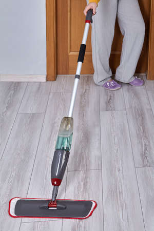 Floor cleaning self spraying mop with microfiber pad and trigger spray on handle. Stock fotó