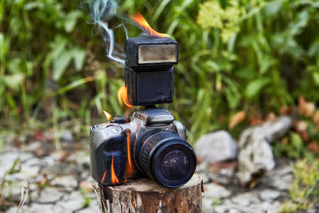 A digital camera is engulfed in flames in a tourist camp during a forest fire.