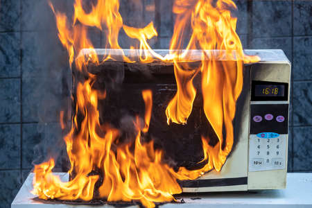 Microwave oven caught fire as result of improper operation.