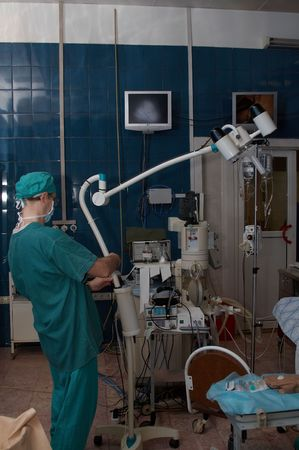 service man and surgical lamp Stock Photo - 741346