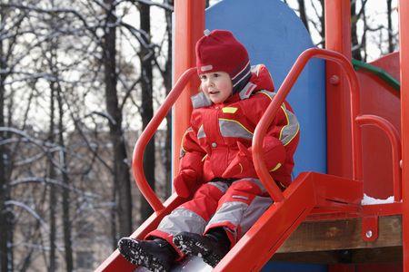 giggle: Little girl on red hillock