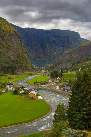 The Flamselvi river winds its way through a glacial u-shaped valley past farms on its way to Flam, Norway and Naeroyfjord