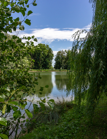 Reflection of trees and sky in the Fourth Lake in Maksimir Park, Zagreb, Croatia 스톡 콘텐츠