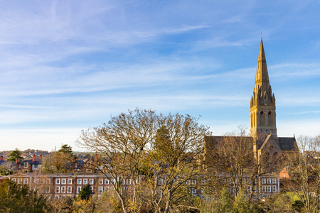View of St Michael's and All Angels' Church in Exeter, England under a blue sky