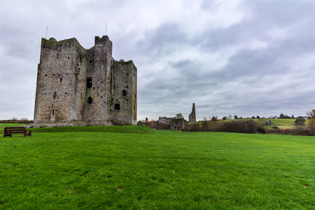 Castle trim in Trim, Ireland with the ruins of Saint Mary's Abbey in the distance