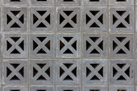 Decorative cinder blocks form a grid pattern of squares and diagonals