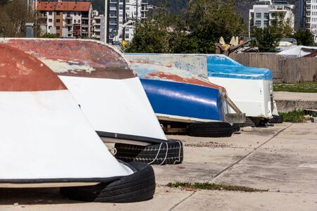 Boats being stored upside down on a sidewalk near Old Town Budva, Montenegro
