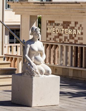March 23, 2019 - Budva, Montenegro - Statue near the entrance of Hotel Mediteran, a popular hotel near Old Town Budva