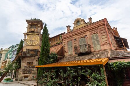 June 21, 2019 - Tbilisi, Georgia - The leaning clock tower in Old Town Tbilisi was designed by the puppeteer Rezo Gabriadze and is attached to his puppet theatre.