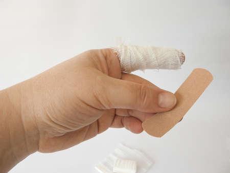bandage or adhesive tape. cut forefinger. white background. Stockfoto