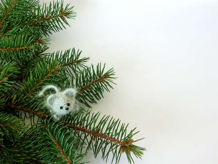 little gray mouse with christmas tree on white background. new year