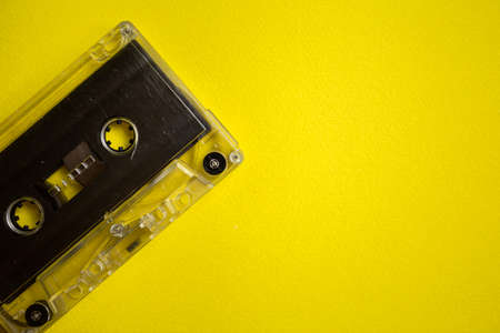 Retro audio cassette on a yellow background
