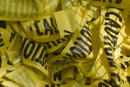 a pile of caution tape in the trash Stok Fotoğraf