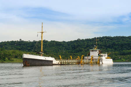 sucks: Ship sucks out sand from the river