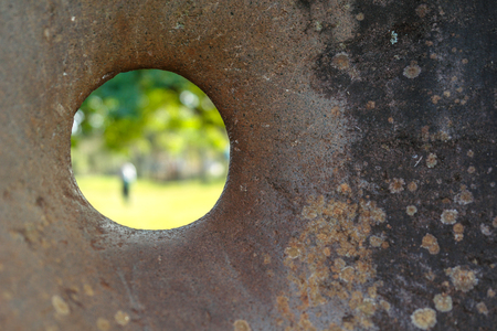 hollow walls: Person through a hole made in stone Stock Photo