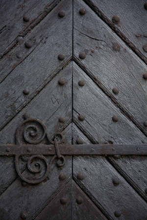antique keyhole: Old door close-up Stock Photo