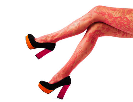 Beautiful women legs with red tights and high heel shoes photo