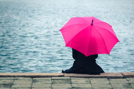 nostalgy: Woman with pink umbrella