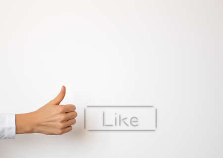 Empty white copyspace with Like button and hand showing thumb up gesture photo