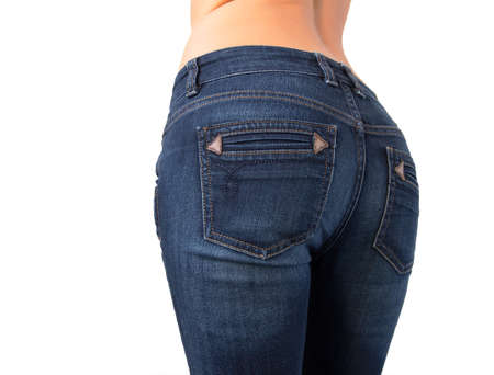 Sexy woman s butt in tight jeans photo