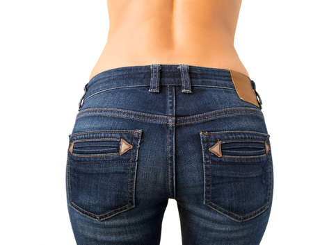 Woman s butt in slim fit jeans photo