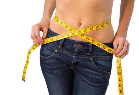 Slim woman measuring her waist photo