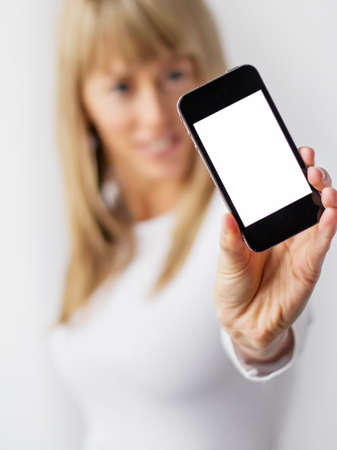 Young woman showing blank mobile phone photo