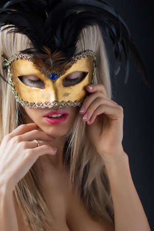Sexy woman in mysterious venetian carnival mask photo
