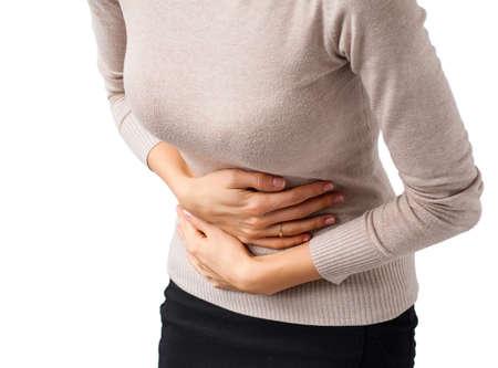 胃の痛みを持っている女性