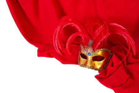 Venetian mask with red feathers on red fabric photo