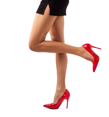 Sexy women legs in red high heel shoes photo