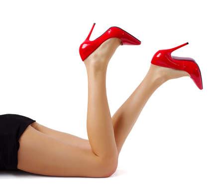 Women legs in red high heel shoes photo