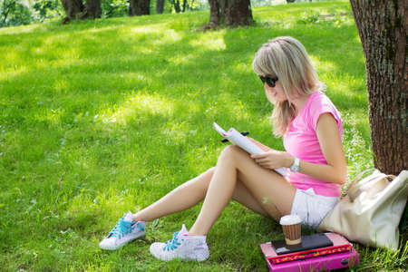 Young student studying in park photo