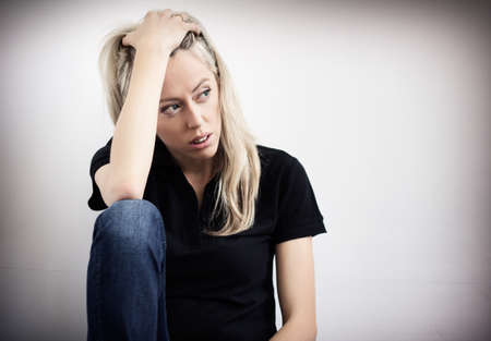 woe: Young unhappy woman in depression