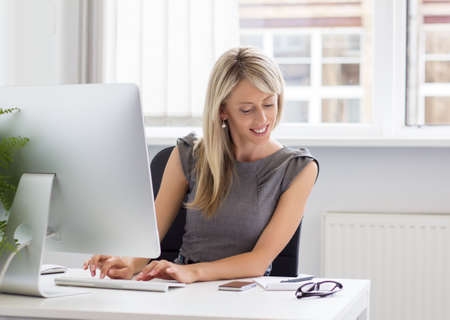 new job: Candid portrait of young creative woman at work   Stock Photo
