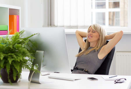 Relaxed woman enjoying successful day at work   photo