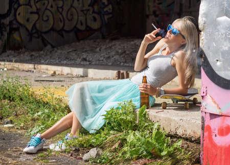drinking problem: Young girl having bad habits Stock Photo