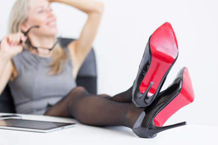 business woman legs: Relaxed woman enjoying successful day at work