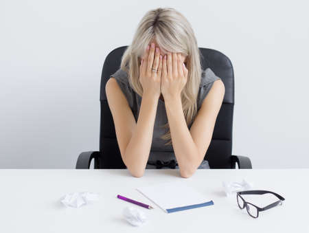 passed out: Overworked young woman sleeping on desk Stock Photo
