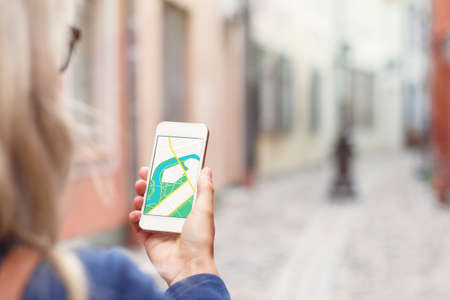 discover: Tourist using navigation app on the mobile phone.