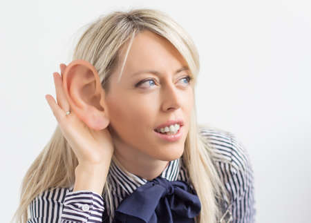 big ear: Woman listening with ridiculously big ear