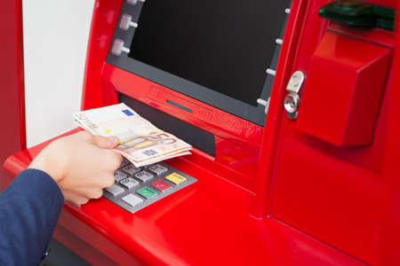 Taking money out of ATM photo