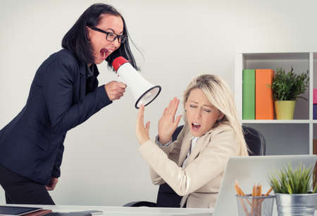 lady boss: Mad boss shouting at employee on megaphone