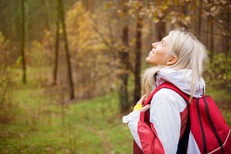 Woman enjoys hiking in wood photo