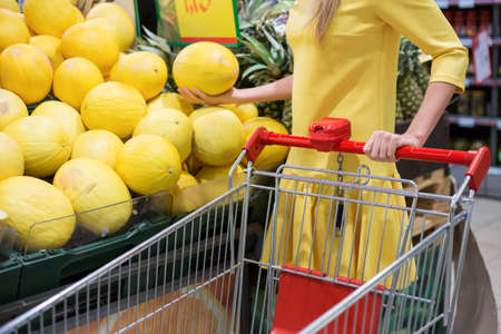 convenience: Woman shopping for fruits in supermarket
