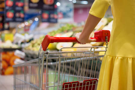 convenient store: Woman shopping for groceries in supermarket Stock Photo