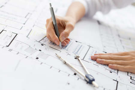architect plans: Architect working on blueprint Stock Photo