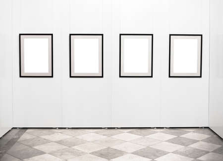 Empty picture frames on the wall in art gallery photo