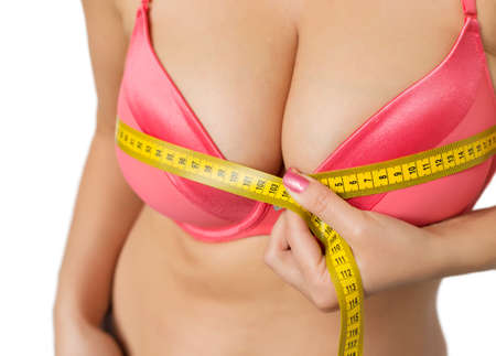 big boobs: Mujer con grandes pechos que mide su busto Foto de archivo